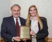 James F. Nielsen, Jr., Business Operations and Development Manager at Baker and Rannells, PA, presents the Baker and Rannells Paralegal Studies Student Graduate Award to RVCC graduate Catherine O'Neill of Frenchtown.